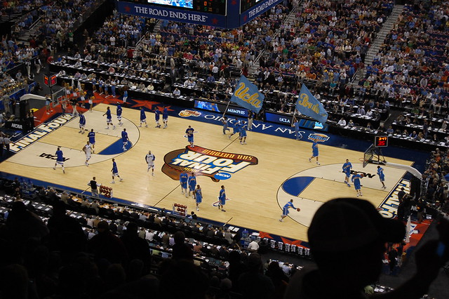 Photo of a basketball court with players for a final four ncaa championship game.