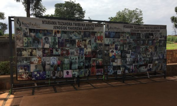 Photo shows a banner with photos of Rwandans lost in an attack on a church during the 1994 genocide at the Ntarama Memorial.