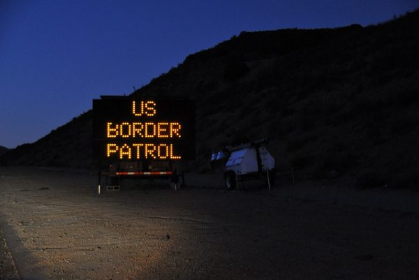Lit-up sign by the road that reads, US Border Patrol.